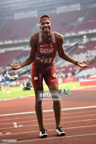 Abderrahman Samba of Qatar celebrates victory after winning Men's 400m Hurdles on day nine of the Asian Games on August 27 2018 in Jakarta Indonesia