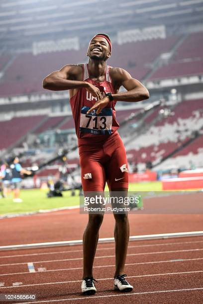Abderrahman Samba of Qatar celebrates victory after winning Men's 400m Hurdles on day nine of the Asian Games on August 27 2018 in Jakarta Indonesia