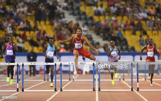 Abderrahman Samba of Qatar clears the final to as he races to victory in the Men's 400 metre hurdles during the Doha IAAF Diamond League 2017 at the...