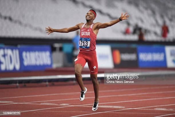 Abderrahman Samba of Qatar crosses the finish line during the Men's 400m Hurdles on day nine of the 2018 Asian Games on August 27 2018 in Jakarta...