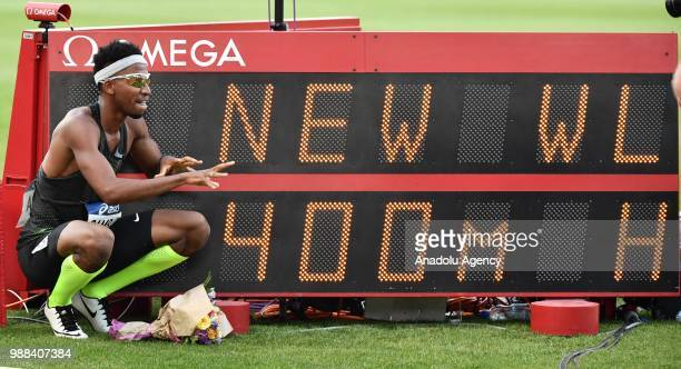 Abderrahman Samba of Qatar poses next to the score board after winning and annual best in the Men's 400m Hurdles at the IAAF Diamond League meeting...