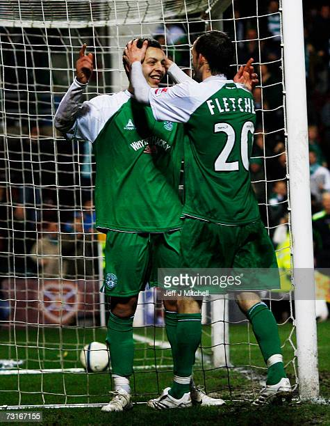 Abdessalam Benjelloun and Steven Fletcher of Hibernian celebrate after scoring against St Johnstone in extra time during the CIS Insurance Cup semi...