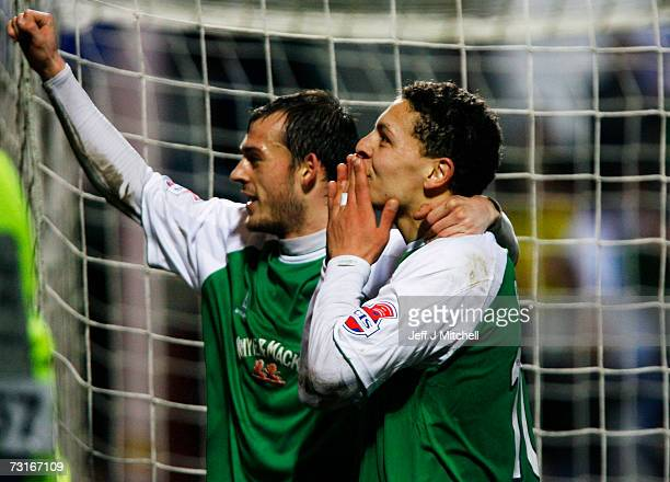 Abdessalam Benjelloun and Steven Fletcher of Hibernian celebrate after the third goal against St Johnstone in extra time during the CIS Insurance Cup...