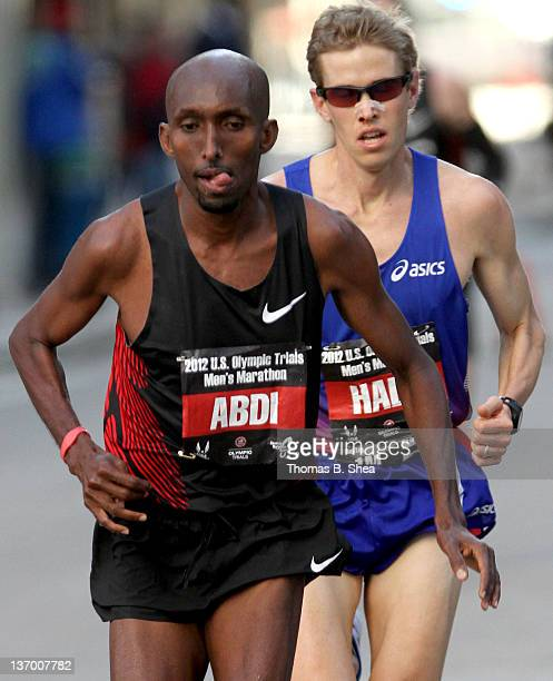 Abdi Abdirahman and Ryan Hall compete in the US Marathon Olympic Trials January 14 2012 in Houston Texas