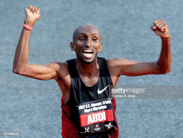 Abdi Abdirahman celebrates as he finishes with a time of 20947 in the US Marathon Olympic Trials January 14 2012 in Houston Texas