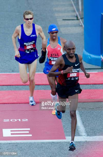 Abdi Abdirahman leads Meb Keflezighi and Ryan Hall during the US Marathon Olympic Trials on January 14 2012 in Houston Texas