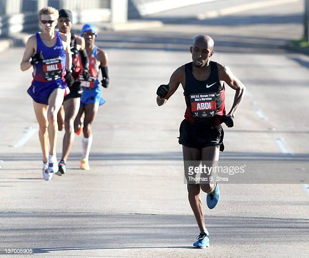 Abdi Abdirahman leads the pack as they compete in the US Marathon Olympic Trials January 14 2012 in Houston Texas