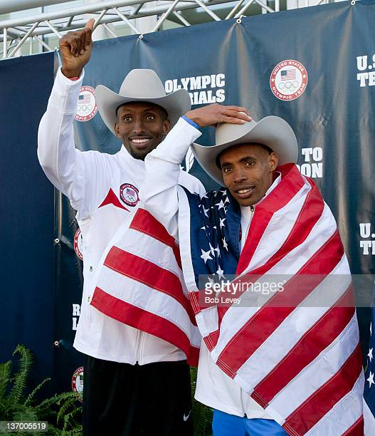 Abdi Abdirahman left and Meb Keflezighi point to supporters in the crowd after they qualified during the US Marathon Olympic Trials on January 14...