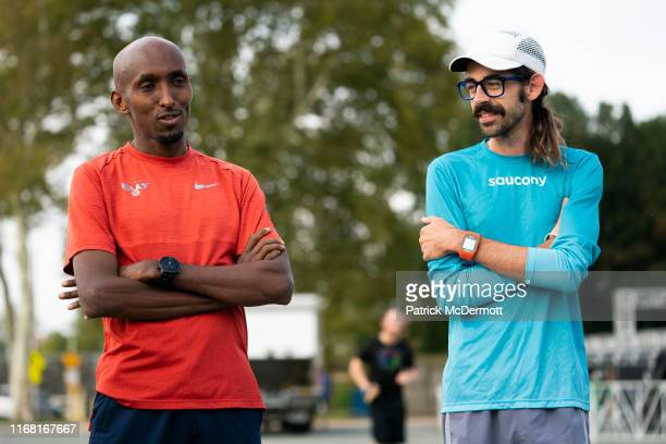 Abdi Abdirahman of the United States and Noah Droddy of the United States take part in a shakeout run with runners taking part in the 15th running of...