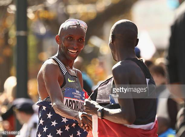 Abdi Abdirahman of the United States celebrates with Lucas Rotich of Kenya after competing in the Professional Men's Division during the 2016 TCS New...