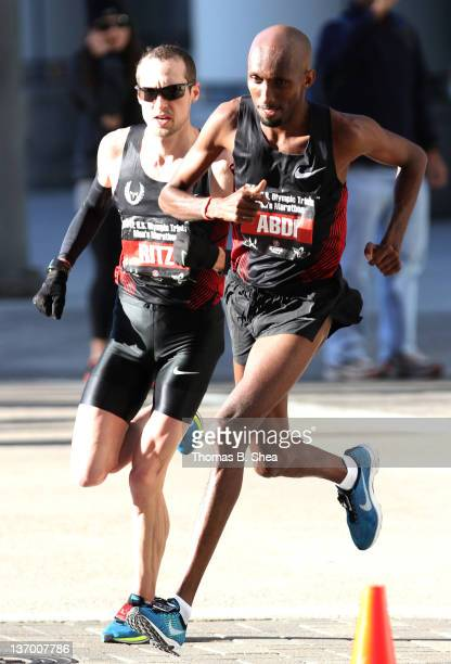 Abdi Abdirahman passes Dathan Ritzenhein as they compete in the US Marathon Olympic Trials January 14 2012 in Houston Texas