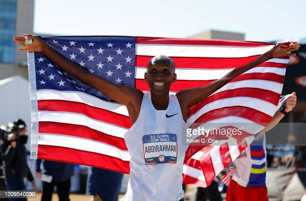 Abdi Abdirahman reacts after finishing in third place during the Men's US Olympic marathon team trials on February 29 2020 in Atlanta Georgia