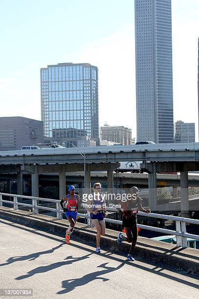Abdi Abdirahman Ryan Hall and Meb Keflezighi compete in the US Marathon Olympic Trials January 14 2012 in Houston Texas