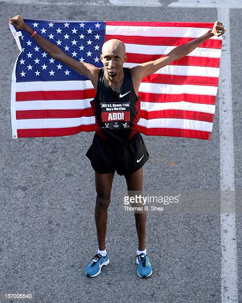 Abdi Abdirahman who finished with a time of 20947 celebrates holding the American Flag as he poses after competing in the US Marathon Olympic Trials...