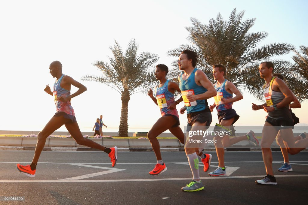 Abdi Abirahman (L) of USA leads from Eyob Daniel (2L) of Italy; Chris Thompson (C) of Great Britain,Arne Gabius (2R) of Germany, and Hendrik Pfeiffer (R) of Germany during the men's elite half marathon on La Corniche. The Ooredoo Doha Marathon is Qatar's largest mass-participation sports event with 2,400 athletes representing 83 countries. The sixth edition included elite athletes competing for prize money of $50,000 in half marathon distance on a 10km loop route along La Corniche on January 12, 2018 in Doha, Qatar.