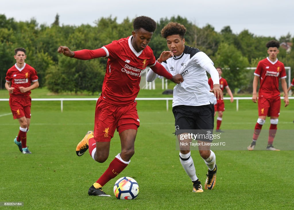 Abdi Sharif of Liverpool and Jayden Mitchell-Lawson of Derby County in action during the Derby County v Liverpool U18 Premier League game at the Derby County Academy on August 11, 2017 in Derby, England.