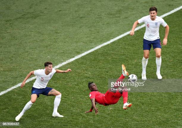Abdiel Arroyo of Panama attempts an overhead kick under pressure from John Stones of England during the 2018 FIFA World Cup Russia group G match...