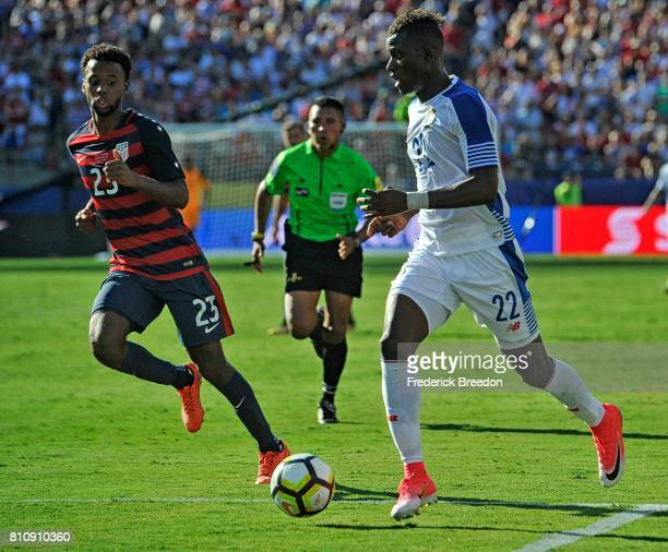 Abdiel Arroyo of Panama controls the ball past Kellyn Acosta of USA during the second half of a CONCACAF Gold Cup Soccer match at Nissan Stadium on...