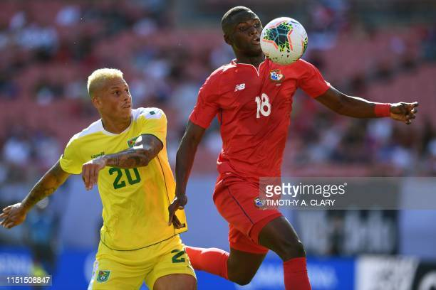 Abdiel Arroyo of Panama passes Matthew Briggs of Guyana during their CONCACAF Gold Cup group stage match at First Energy Stadium in Cleveland, Ohio...