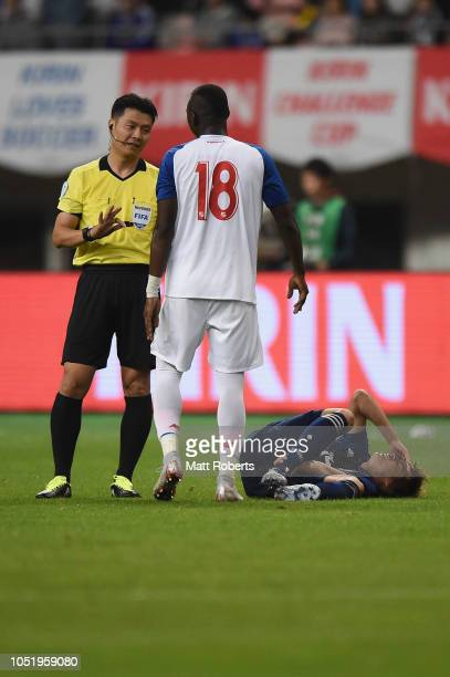 Abdiel Arroyo of Panama speaks with the referee Dong Jin Kim during the international friendly match between Japan and Panama at Denka Big Swan...