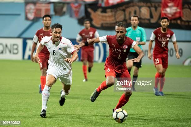 Abdil Qaiyyim of Home United is pursued by Addison Oliveira of Persija Jakarta during the AFC Cup Zonal Semi final between Home United and Persija...