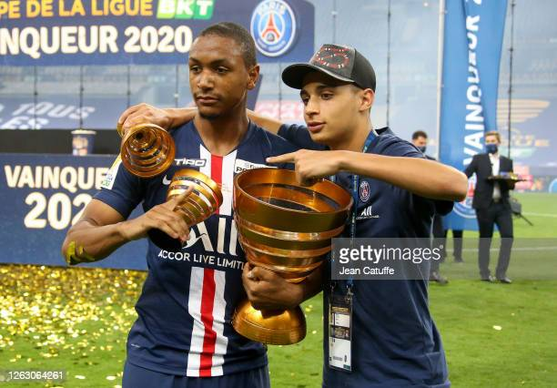 Abdou Diallo Kays RuizAtil of PSG celebrate the victory following the French League Cup final between Paris SaintGermain and Olympique Lyonnais at...
