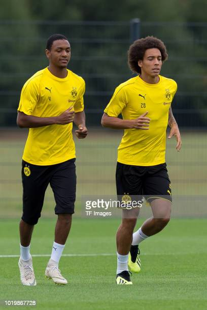 Abdou Diallo of Borussia Dortmund and Axel Witsel of Borussia Dortmund run during the Borussia Dortmund training session on August 15 2018 in...