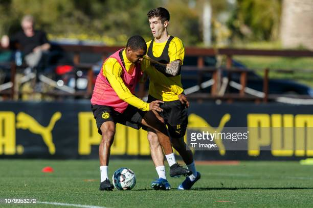 Abdou Diallo of Borussia Dortmund and Christian Pulisic of Borussia Dortmund battle for the ball during a training session as part of the Borussia...