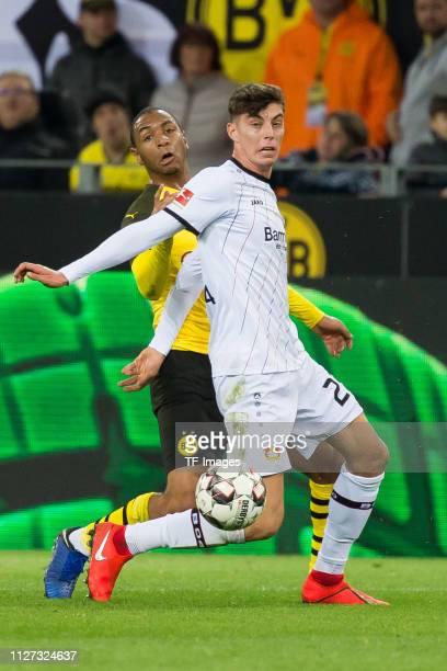 Abdou Diallo of Borussia Dortmund and Kai Havertz of Bayer 04 Leverkusen battle for the ball during the Bundesliga match between Borussia Dortmund...