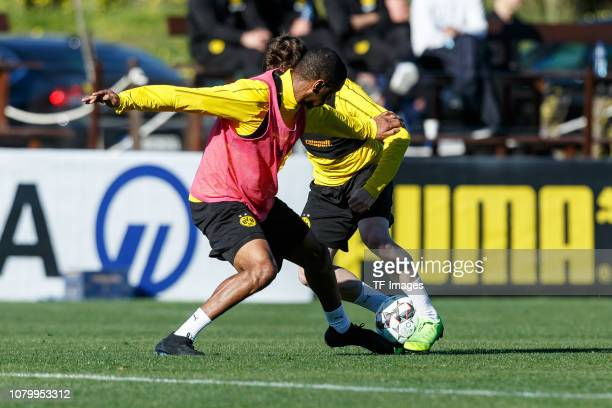 Abdou Diallo of Borussia Dortmund and Sergio Gomez of Borussia Dortmund battle for the ball during a training session as part of the Borussia...