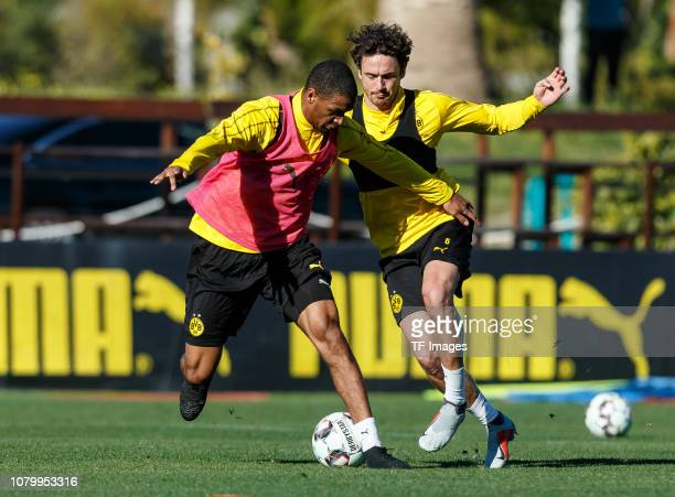 Abdou Diallo of Borussia Dortmund and Thomas Delaney of Borussia Dortmund battle for the ball during a training session as part of the Borussia...