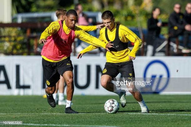 Abdou Diallo of Borussia Dortmund and Tobias Raschl of Borussia Dortmund battle for the ball during a training session as part of the Borussia...