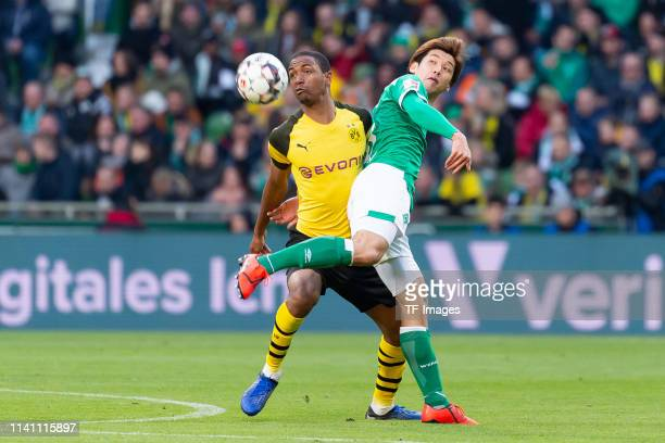 Abdou Diallo of Borussia Dortmund and Yuya Osako of SV Werder Bremen battle for the ball during the Bundesliga match between SV Werder Bremen and...