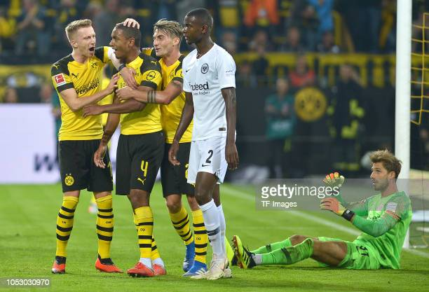 Abdou Diallo of Borussia Dortmund celebrates after scoring his team`s first goal with team mates during the Bundesliga match between Borussia...