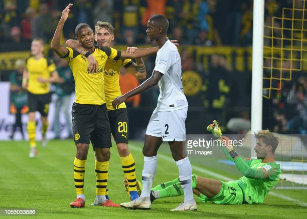 Abdou Diallo of Borussia Dortmund celebrates after scoring his team`s first goal with Maximilian Philipp of Borussia Dortmund during the Bundesliga...