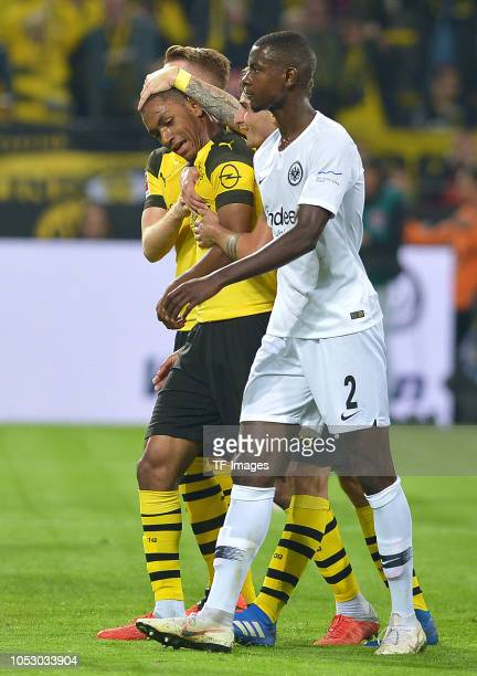 Abdou Diallo of Borussia Dortmund celebrates after scoring his team`s first goal and Evan N'u2019Dicka of Eintracht Frankfurt looks dejected during...