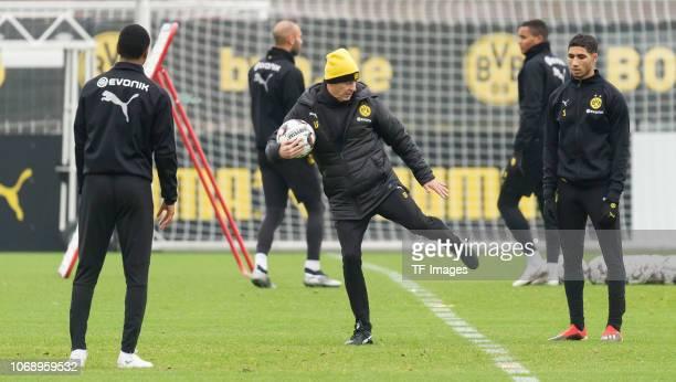 Abdou Diallo of Borussia Dortmund Head coach Lucien Favre of Borussia Dortmund and Achraf Hakimi of Borussia Dortmund during a training session at...