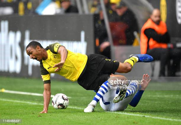 Abdou Diallo of Borussia Dortmund is tackled by Sebastian Rudy of FC Schalke 04 during the Bundesliga match between Borussia Dortmund and FC Schalke...