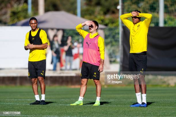 Abdou Diallo of Borussia Dortmund Mario Goetze of Borussia Dortmund and DanAxel Zagadou of Borussia Dortmund looks on during a training session as...