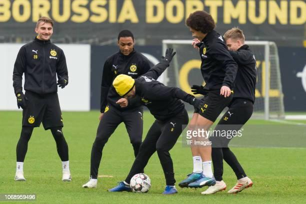 Abdou Diallo of Borussia Dortmund Paco Alcacer of Borussia Dortmund and Axel Witsel of Borussia Dortmund battle for the ball during a training...