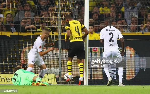 Abdou Diallo of Borussia Dortmund scores his team's first goal past Kevin Trapp of Eintracht Frankfurt during the Bundesliga match between Borussia...