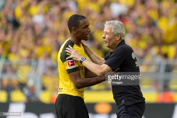 Abdou Diallo of Borussia Dortmund speaks with Head coach Lucien Favre of Borussia Dortmund during the Bundesliga match between Borussia Dortmund and...