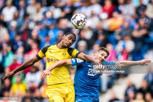 Abdou Diallo of Dortmund and Andrej Kramaric of Hoffenheim fight for the ball during the Bundesliga match between TSG 1899 Hoffenheim and Borussia...
