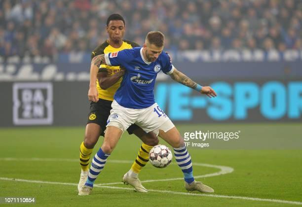 Abdou Diallo of Dortmund and Guido Burgstaller of Schalke battle for the ball during the Bundesliga match between FC Schalke 04 and Borussia Dortmund...