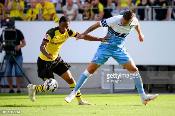 Abdou Diallo of Dortmund and Sergej MilinkovicSavic of Lazio battle for the ball during the friendly match between Borussia Dortmund and Lazio on...