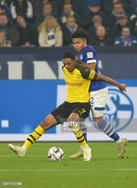 Abdou Diallo of Dortmund and Weston McKennie of Schalke battle for the ball during the Bundesliga match between FC Schalke 04 and Borussia Dortmund...