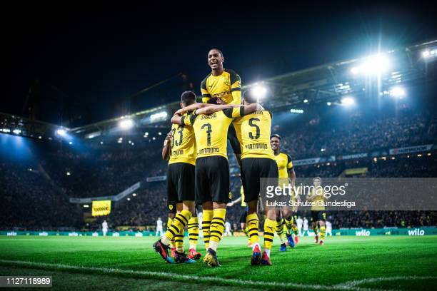 Abdou Diallo of Dortmund celebrates with Julian Weigl Jadon Sancho and Aschraf Hakimi their teams second goal during the Bundesliga match between...