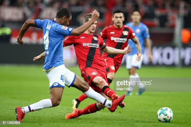 Abdou Diallo of FSV Mainz 05 and Lars Bender of Bayer Leverkusen battle for the ball during the Bundesliga match between Bayer 04 Leverkusen and 1...