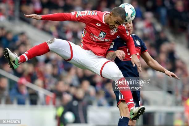 Abdou Diallo of FSV Mainz Rafinha of Bayern Munchen during the German Bundesliga match between FSV Mainz v Bayern Munchen at the Opel Arena on...