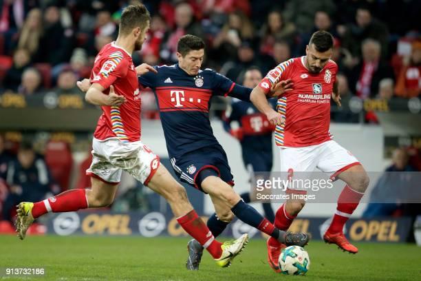 Abdou Diallo of FSV Mainz Robert Lewandowski of Bayern Munchen Giulio Donati of FSV Mainz during the German Bundesliga match between FSV Mainz v...